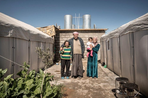 Hussein with daughters and grand daughter, Kawergosk Refugee Camp, Erbil, Iraq March 2015 Photo: © Better Shelter