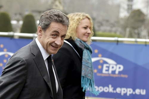 Sarkozy arrives at a EPP meeting in Brussels ahead of a European Union leaders summit