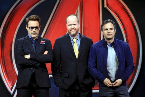 """Director Joss Whedon poses with cast members Robert Downey Jr. and Mark Ruffalo at a news conference for """"Avengers: Age of Ultron"""" in Beijing"""
