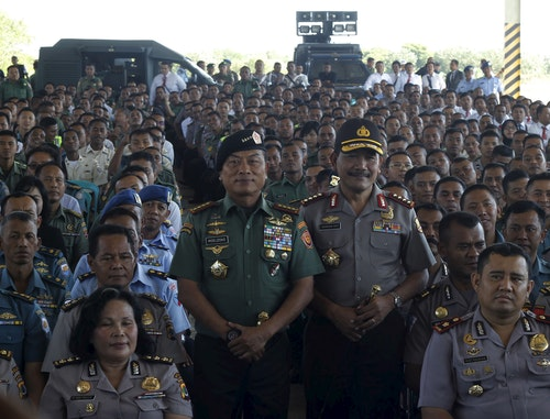 Indonesia's military chief Commander General Moeldoko and National Police Chief General Badrodin Haiti pose with members of the military and police after a briefing in Kupang, East Nusa Tenggara