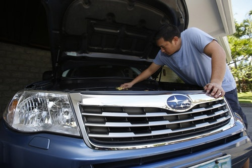 Kasilag, a senior marketing consultant at a multinational company, cleans his car in his garage in the wealthy Ayala Alabang subdivision in Las Pinas