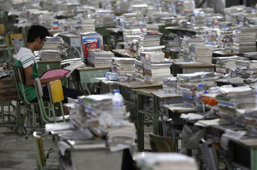 All kinds of textbooks and reference books on the desks of study rooms. Statistics show students  taking the college entrance exam need to read at least 108 to 125 books. Photo Credit: Reuters