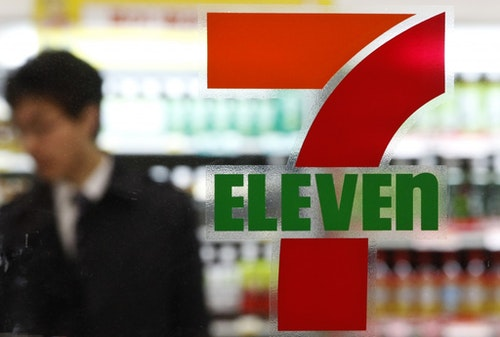 A customer is seen at a 7-Eleven convenience store in Tokyo