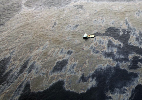 An aerial view shows oil that seeped from a well operated by Chevron at Frade, on the waters in Campos Basin in Rio de Janeiro state