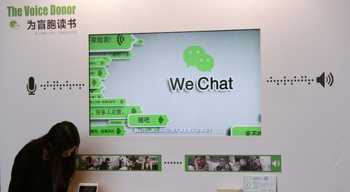 A counter promoting WeChat on reading books for the blind, is displayed at a news conference in Hong Kong