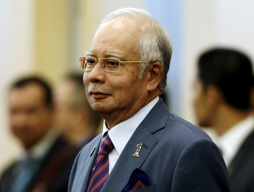 Malaysia's Prime Minister Najib Razak arrives at the 48th ASEAN foreign ministers meeting in Kuala Lumpur, Malaysia