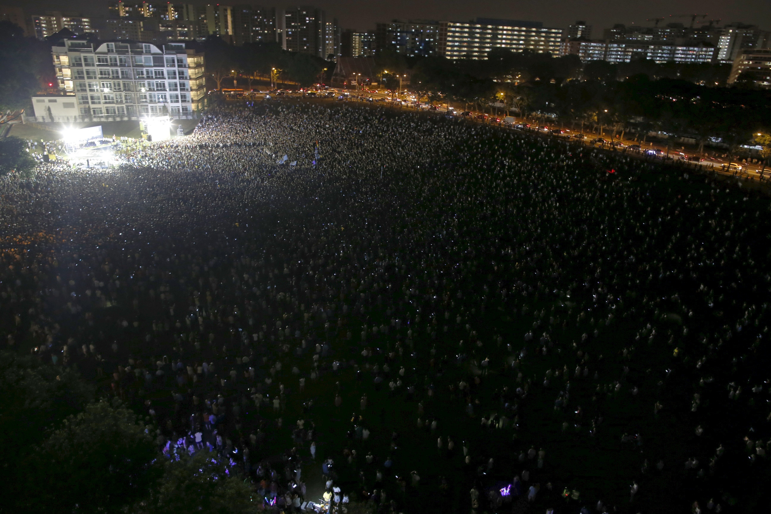 People attend an election campaign rally by the opposition Workers' Party in Singapore