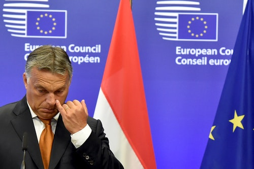 Hungary's Prime Minister Orban holds a news conference with European Council President Tusk at the European Council headquarters ahead of their meeting in Brussels