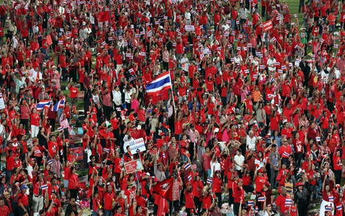 Red-shirted supporters attend a rally at Rajamangala national stadium in Bangkok