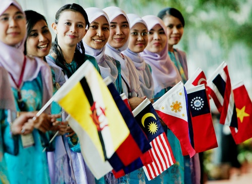 Malaysian girls holding ASEAN countries flags