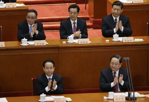 Ling Jihua, newly elected vice chairman of the CPPCC, and other China's top leaders applaud during the opening ceremony of the CPPCC in Beijing