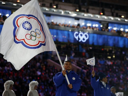Taiwan's flag-bearer Sung Ching-Yang leads his country's contingent during the athletes' parade at the opening ceremony of the 2014 Sochi Winter Olympics
