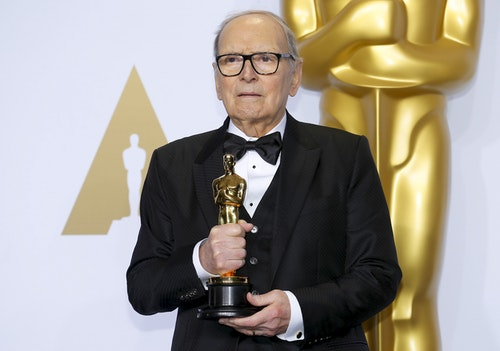 "Italian composer Ennio Morricone poses with his Oscar for Best Original Score for ""The Hateful Eight,"" during the 88th Academy Awards in Hollywood"