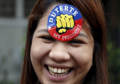 A supporter of presidential candidate Rodrigo Duterte is pictured during election campaigning for May 2016 national elections in Malabon, Metro Manila