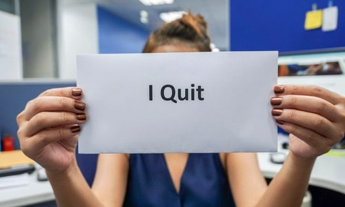close up woman hold a piece of paper of I quit the job