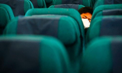 Passengers remain in their seats onboard Malaysia Airlines Boeing 777-200ER flight MH318 as it cruises towards Beijing over the South China Sea