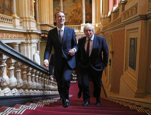 New Foreign Secretary Boris Johnson is welcomed to the Foreign Office by Sir Simon McDonald