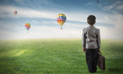 Concept of future of a young boy in a green field
