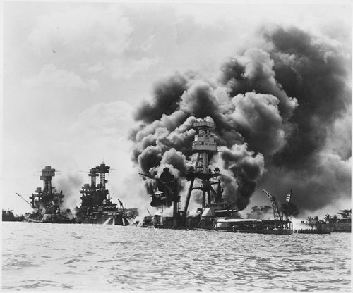 Aftermath of a Japanese sneak attack on these three stricken U.S. battleships; from left to right: USS West Virginia (severely damaged), USS Tennessee (damaged), and the USS Arizona (sunk)