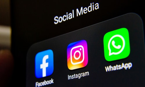 Social media products from Facebook company: Facebook, Instagram, WhatsApp apps on the smartphone screen. Stafford, UK - September 20 2019.