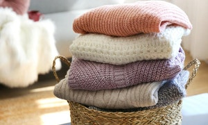 pile-of-knitted-sweaters-of-different-co